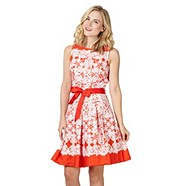 I couldn't resist adding one more tea dress into the mix! Red Herring at Debenhams is offering this bright and lacy lovely for only £36 complete with sash. Orange heels and bright orange gerberas would complete this tang-tastic look!