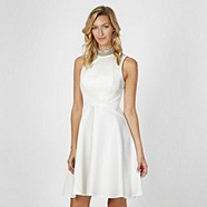 Are you brave enough for your best girls to wear white? If so, play it down with Julien MacDonald and his super striking skater style dress with built in neck detail for only £70. This gives you lot's of flexibility when it comes to accessorising AND you save money on the necklace - bonus!